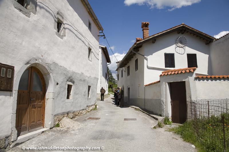 Typical limestone houses in a street in Stanjel, Karst region, Slovenia