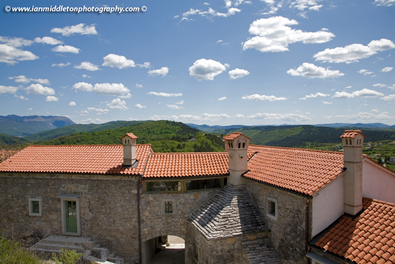 Typical red tiled roofs with limetone chimney in Stanjel, Karst region, Slovenia