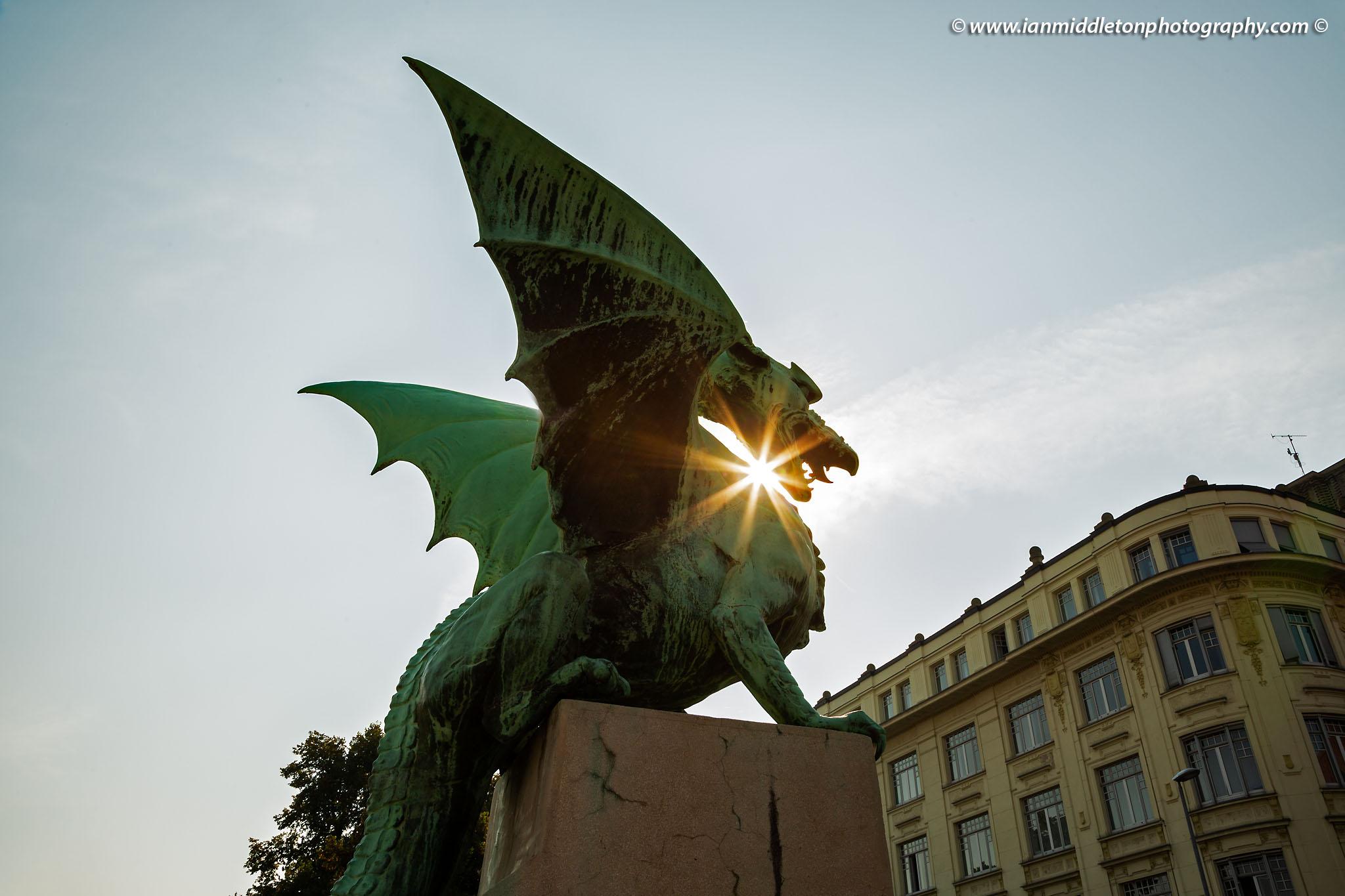 Sunburst through a dragon on the Dragon Bridge in Ljubljana, Slovenia.