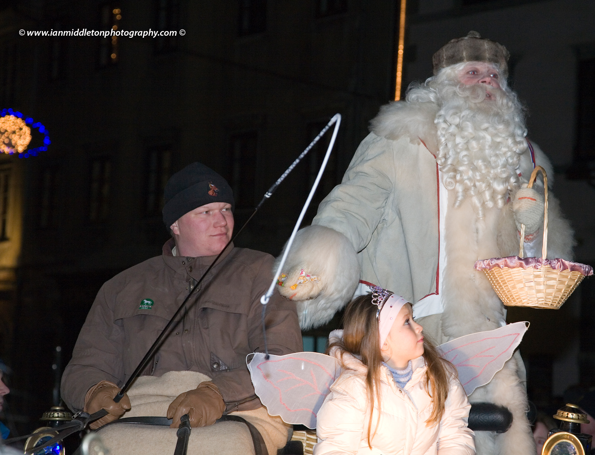 Dedek Mraz procession in Ljubljana, Slovenia. Also known as Grandfather Cold or Grandfather Frost, this tradition was used by the communists as a replacement for the western Santa Claus. The tradition comes from a ancient Russian Legend of Ded Moroz, and he wears a white outfit and Russian Kuchma Hat.