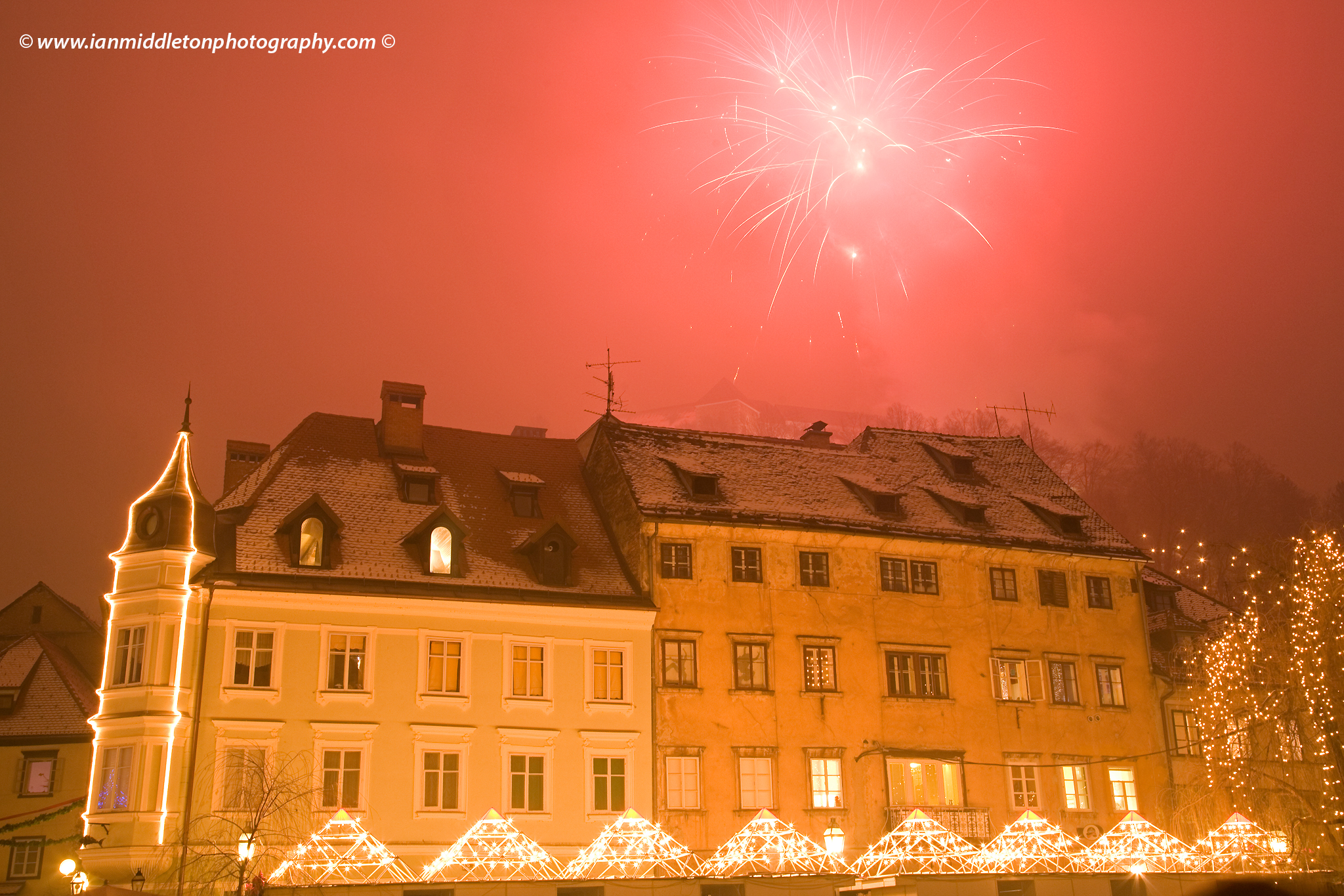 Fireworks from Castle above old town in Ljubljana, Slovenia for new years eve 2007/2008. Unfortunately fog obscured the castle.