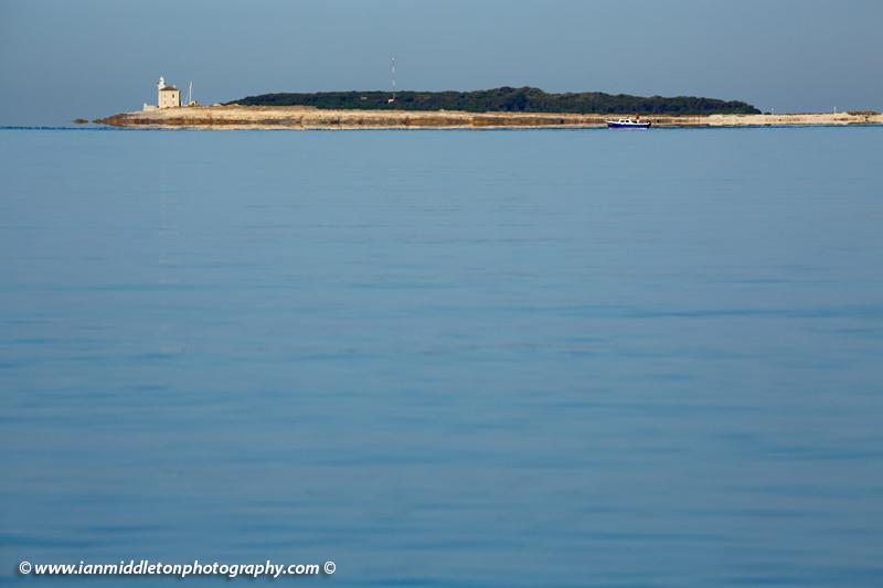 Lighthouse at the southern end of Veli Brijuni Island, Croatia. Seen from Puntižela Beach, Štinjan north of Pula.