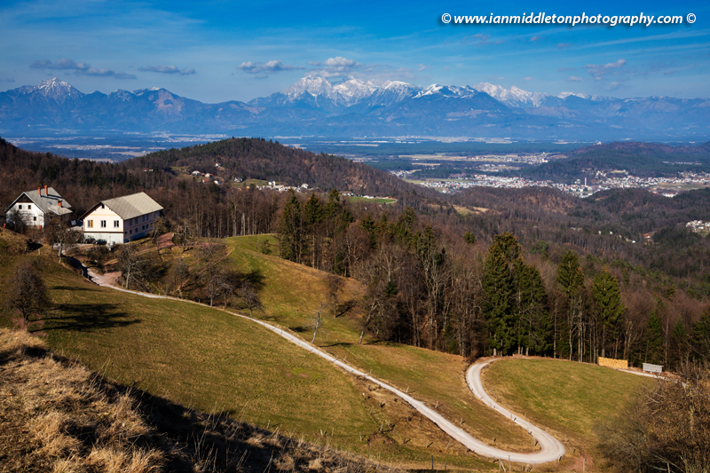 View of the Kamnik Alps in the Polhov Gradec Hill Range., on a hiking trail to the church of Saint Jacob (Sveti Jakob) near Medvode, Slovenia.