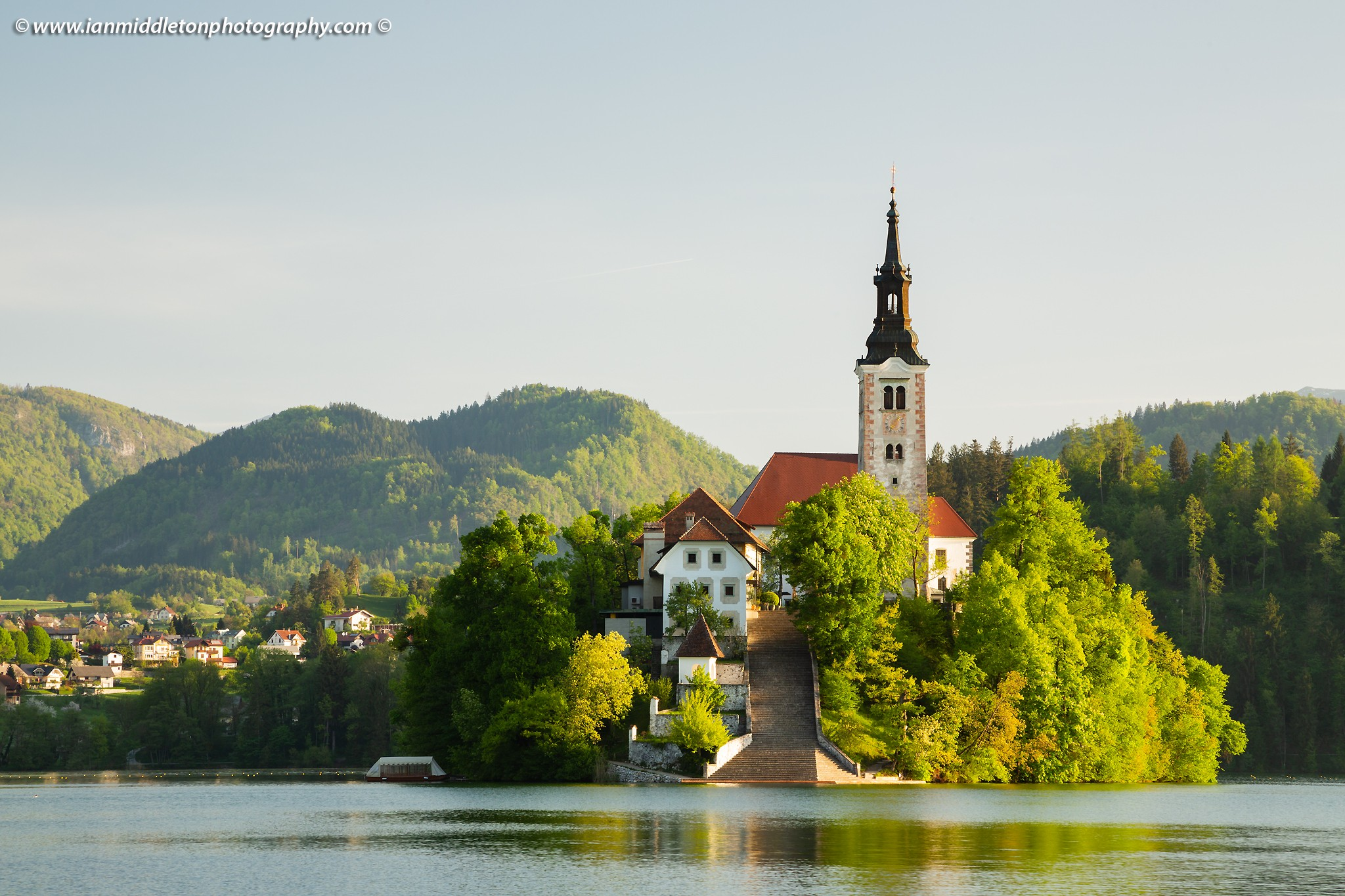 Spring morning view across Lake Bled to the island church of the assumption of saint mary, Slovenia.