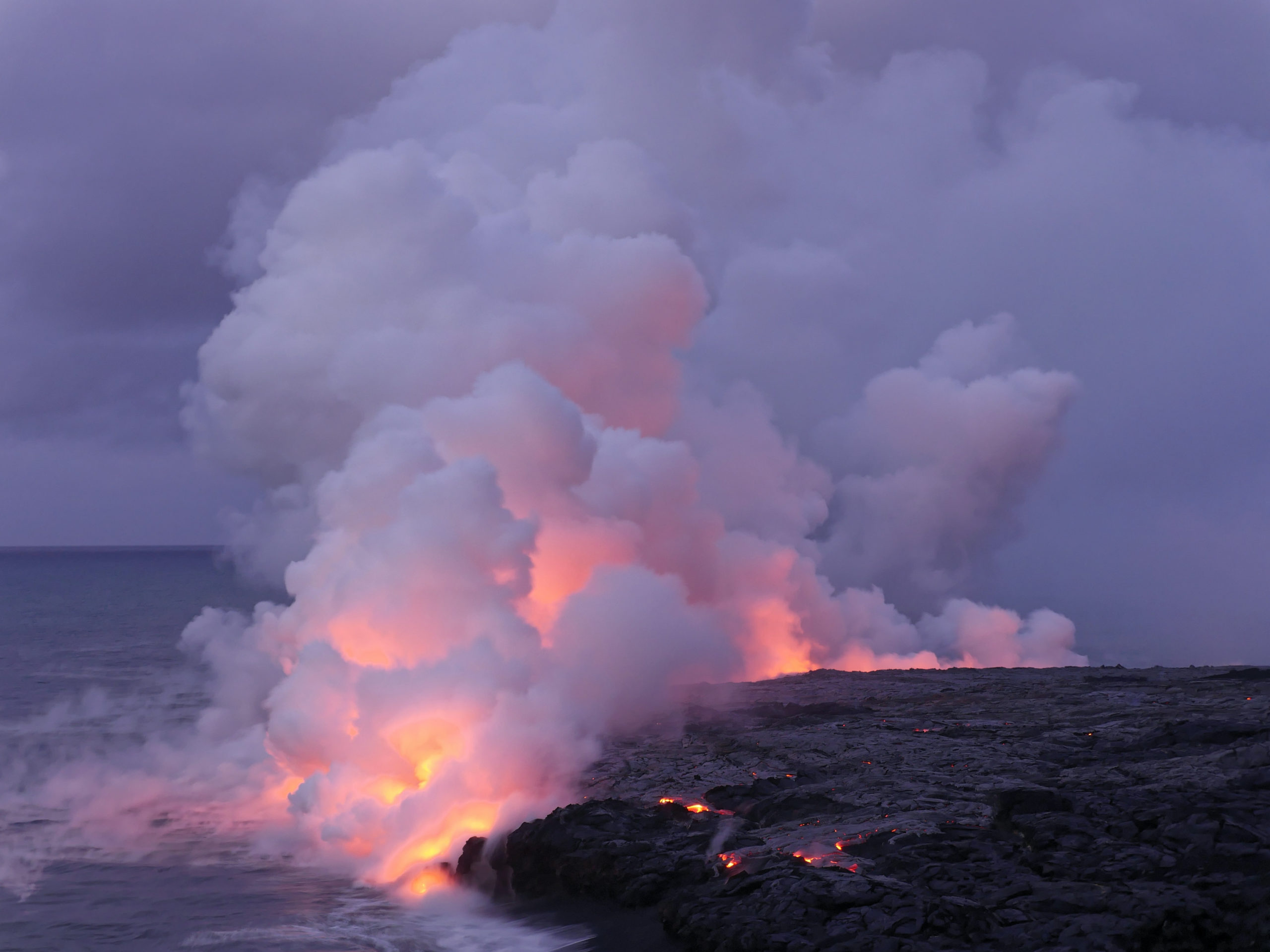 Lava flowing into the sea from Kilauea in Hawaii volcano national park. Photo by Marc Szeglat on Unsplash
